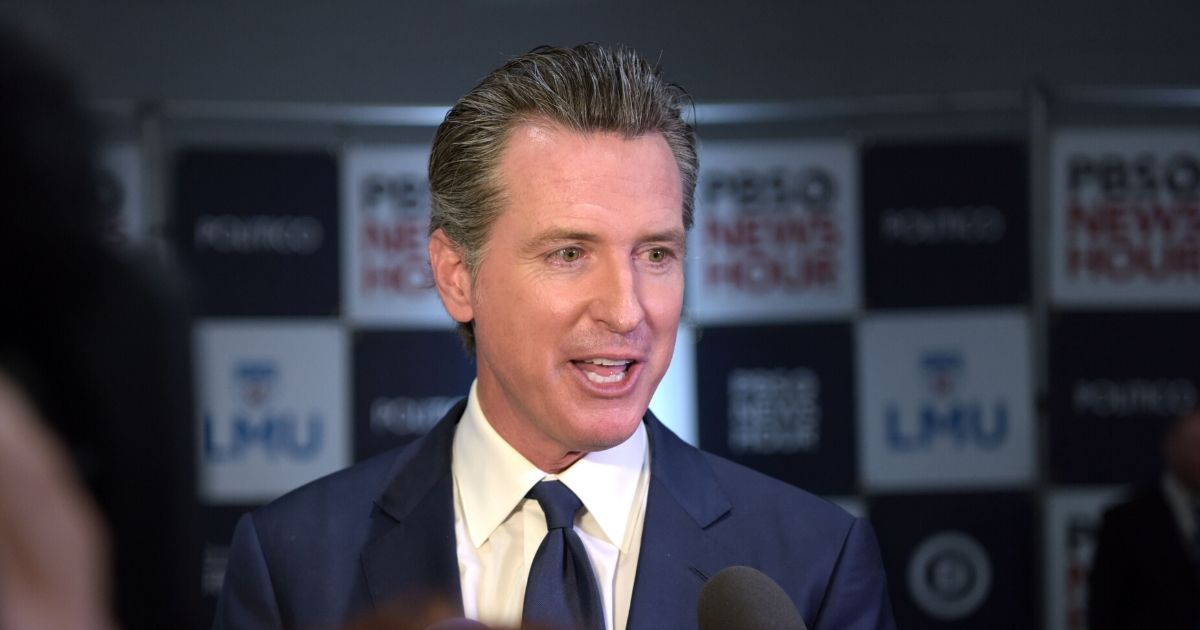 Democratic California Gov. Gavin Newsom speaks to the media in the spin room after the sixth Democratic primary debate of the 2020 presidential campaign season co-hosted by PBS NewsHour & Politico at Loyola Marymount University in Los Angeles on Dec. 19, 2019.