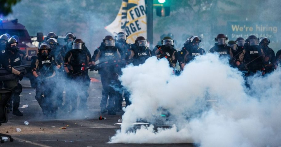 "Minneapolis police in riot gear prepare to confront rioters Saturday as looting continues after ""protests"" of a man in police custody on Monday."
