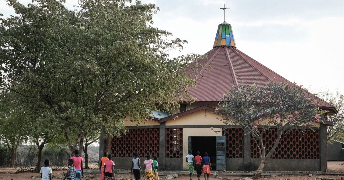 Girls who escaped female genital mutilation or child marriage walk into a church next to Kalas Girls primary school in the town of Amudat in northeastern Uganda in January 2018.