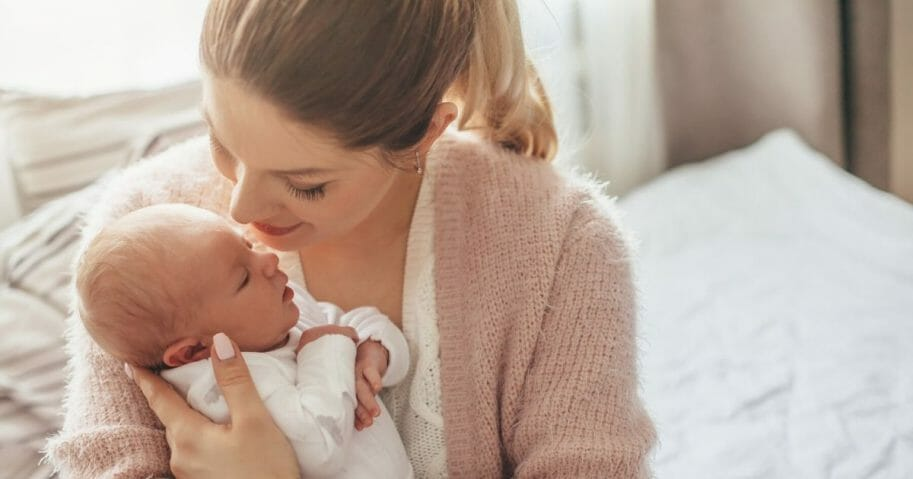 Stock image of a mother and her newborn baby.