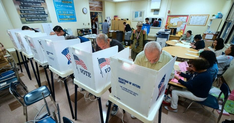 People cast their ballots in voting booths at the 2nd Street Elementary School in the Boyle Heights neighborhood of Los Angeles on Nov. 6, 2018, as Americans across the country cast their votes for the midterm elections.