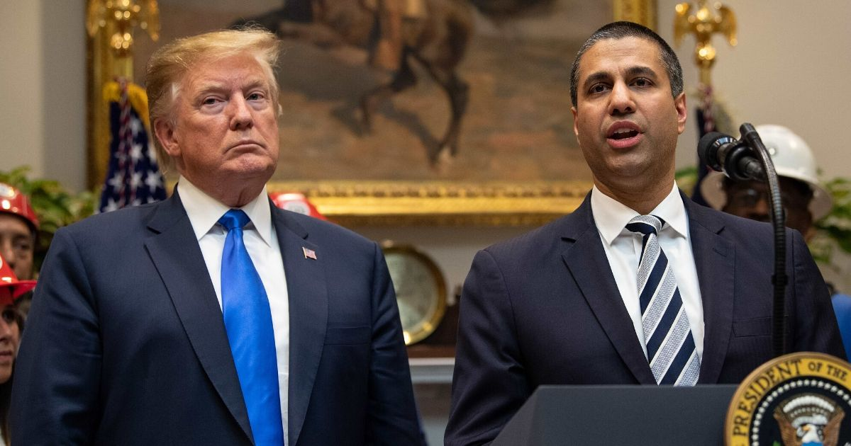 President Donald Trump listens to Federal Communications Commission Chairman Ajit Pai speak during an announcement about 5G network deployment in the Roosevelt Room at the White House in Washington, DC, on April 12, 2019.