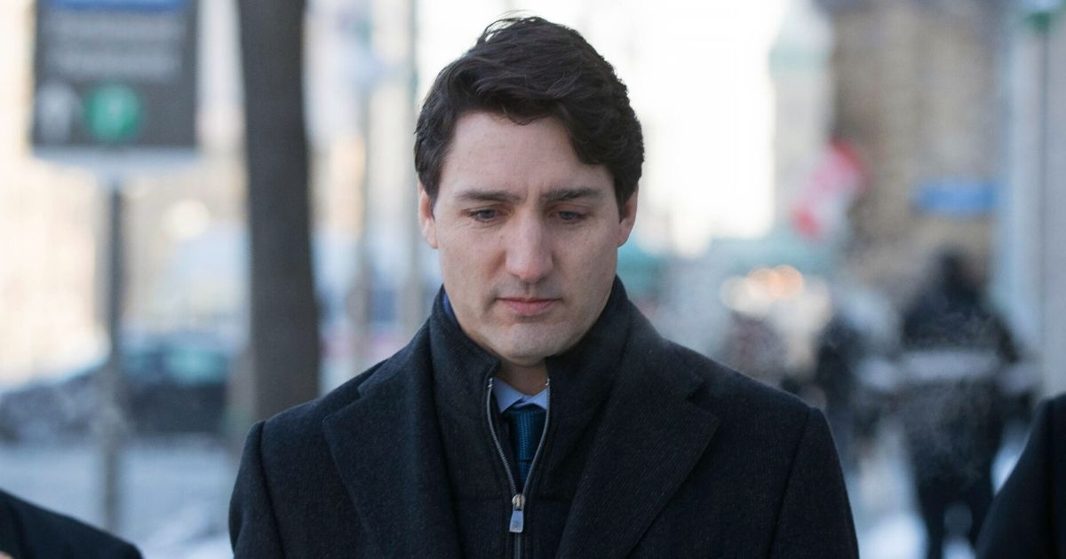 Canadian Prime Minister Justin Trudeau walks to a news conference from the prime minister's office in Ottawa, Ontario, on March 7, 2019.
