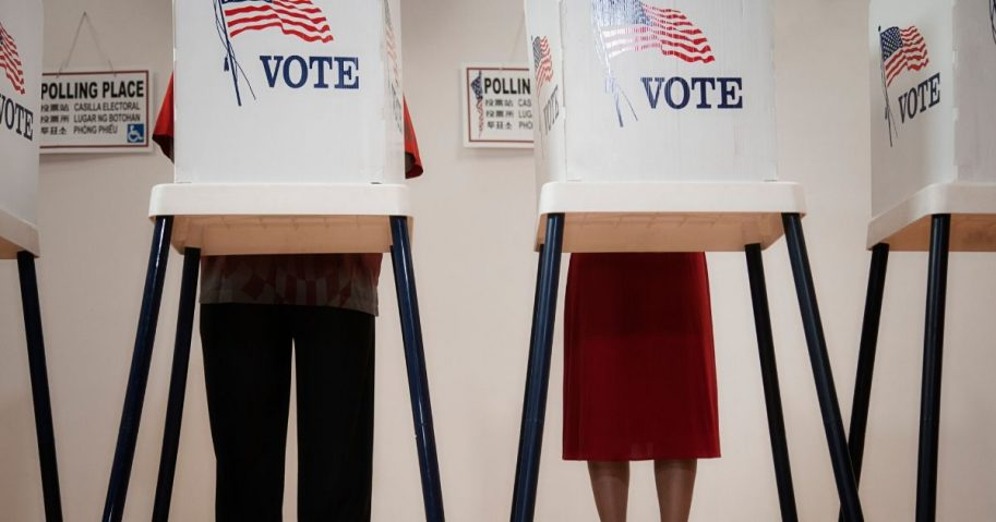 Voters cast ballots in the stock image above.