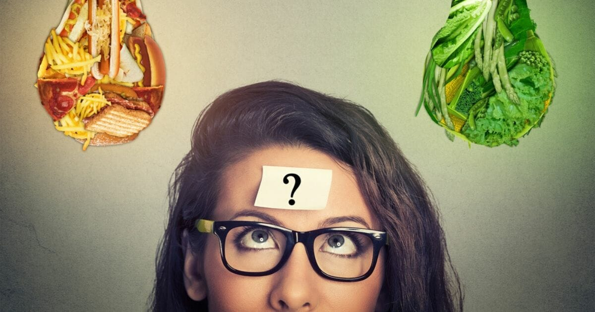 A woman ponders her food choices in the stock image above.