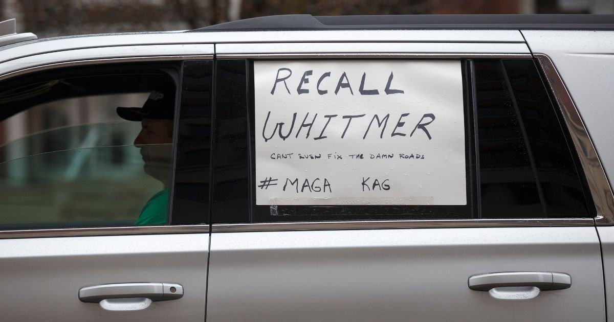 a-man-on-his-way-to-protest-Gov.-Whitmer