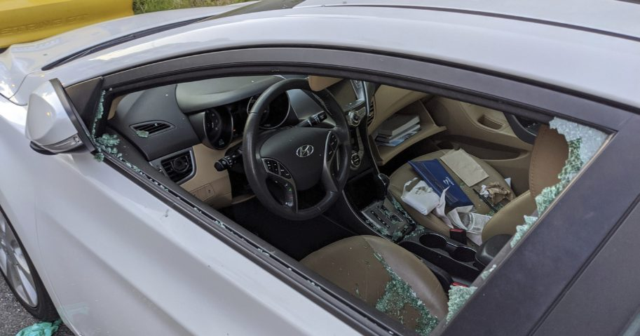 A parked car with a broken driver's side window is seen May 21, 2020, after a smash-and-grab break-in in Los Angeles.