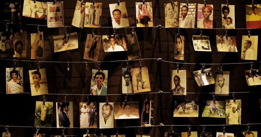 In this April 5, 2019, file photo, family photographs of some of those who died hang on display in an exhibition at the Kigali Genocide Memorial centre in the capital Kigali, Rwanda.