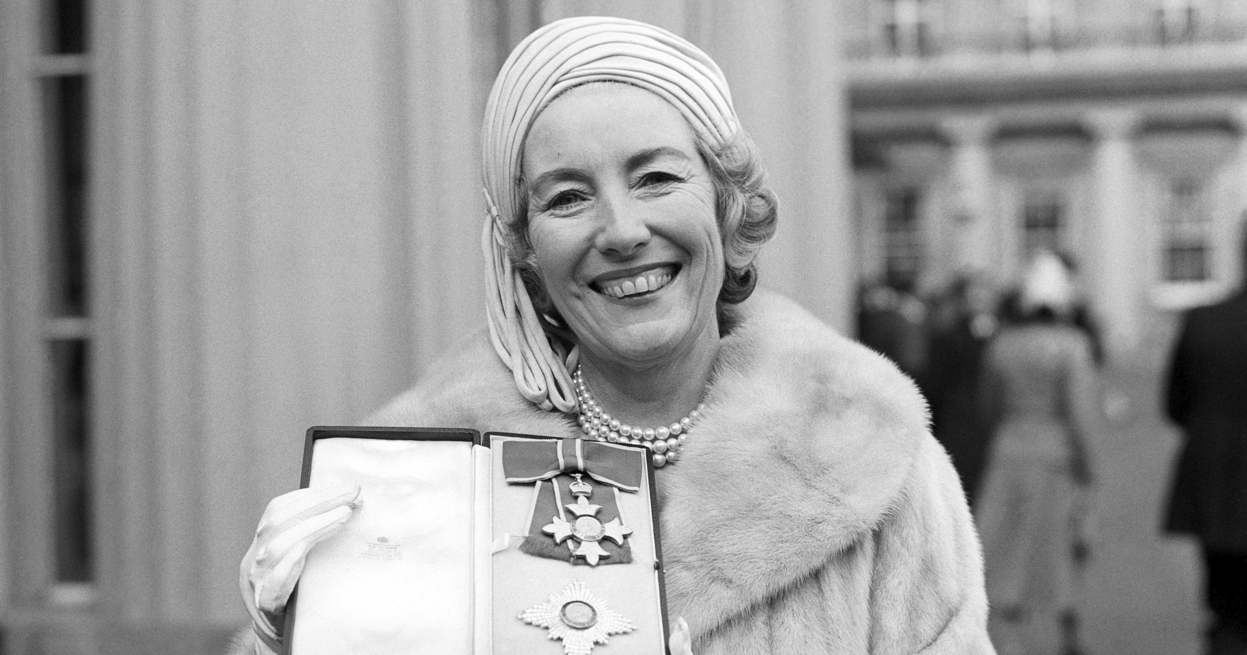 Singer Vera Lynn poses outside Buckingham Palace on Dec. 2, 1975, after being invested a Dame Commander of the British Empire.