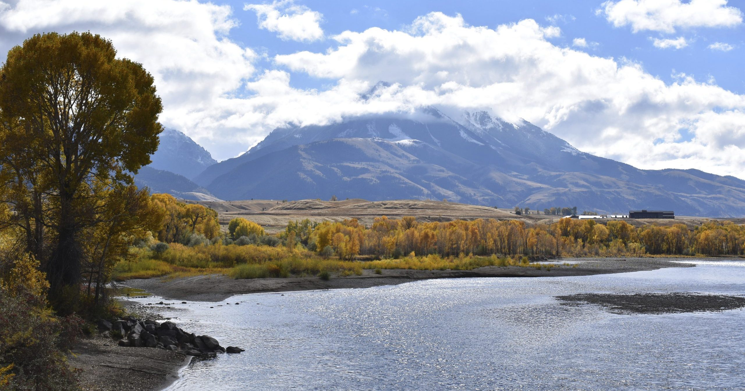 In this Oct. 8, 2018, file photo, Emigrant Peak is seen rising above the Paradise Valley and the Yellowstone River near Emigrant, Montana. Lawmakers have reached bipartisan agreement on a deal to double spending on a popular conservation program and devote nearly $2 billion a year to improve and maintain national parks.