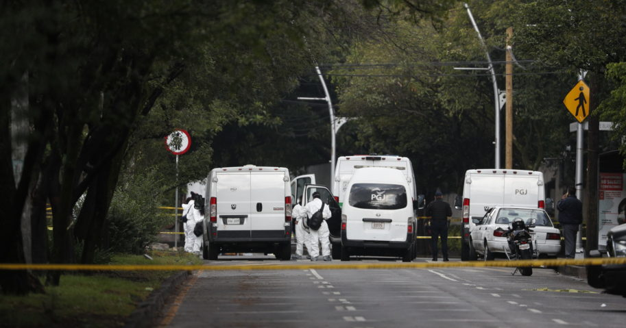 Forensic investigators and police work the scene where Security Secretary Omar García Harfuch was attacked by gunmen in Mexico City on June 26, 2020.