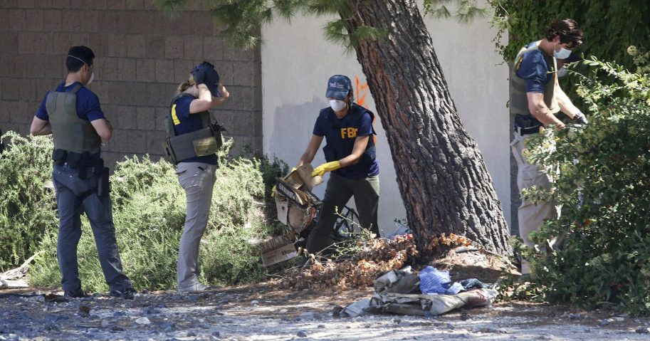 FBI agents examine an area in Paso Robles, California, on June 11, 2020, after the shooting of a sheriff's deputy early Wednesday. The gunman, 26-year-old Mason James Lira, was killed by police in a shootout on Thursday.