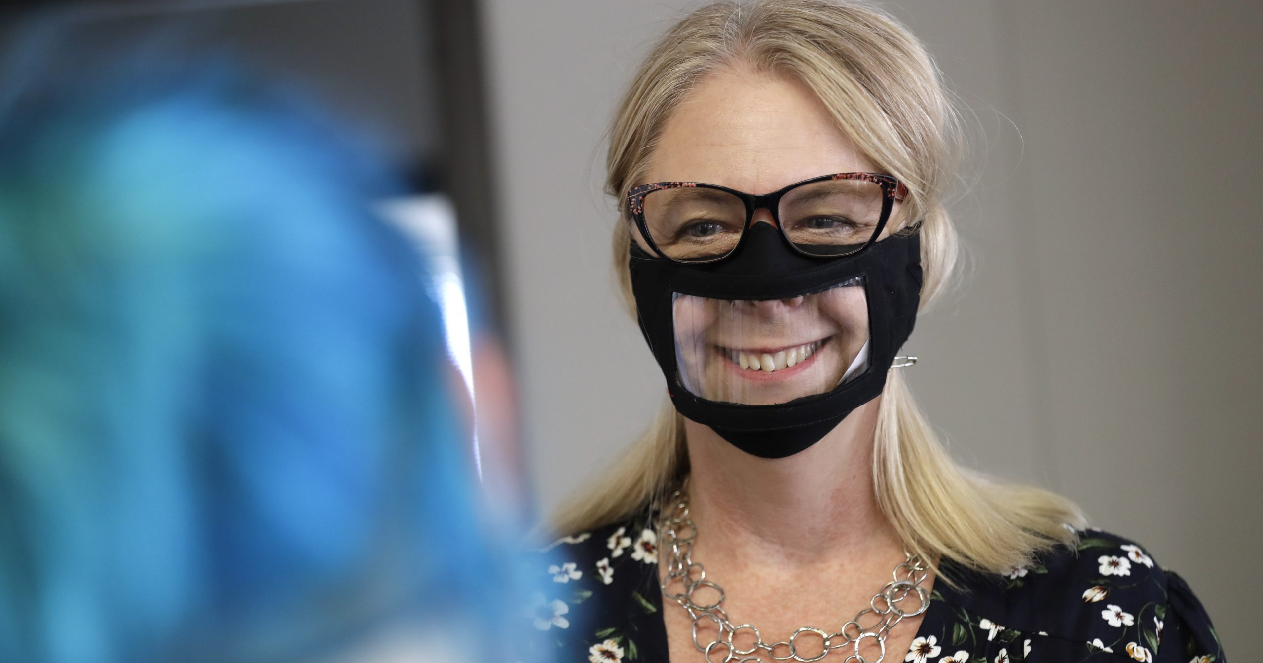 In this June 3, 2020, photo, Chris LaZich of Fleet Science Center wears a mask with a window in San Diego. Face coverings are making it hard for people who read lips to communicate, which has spurred a slew of startups making masks with plastic windows to show one's mouth.