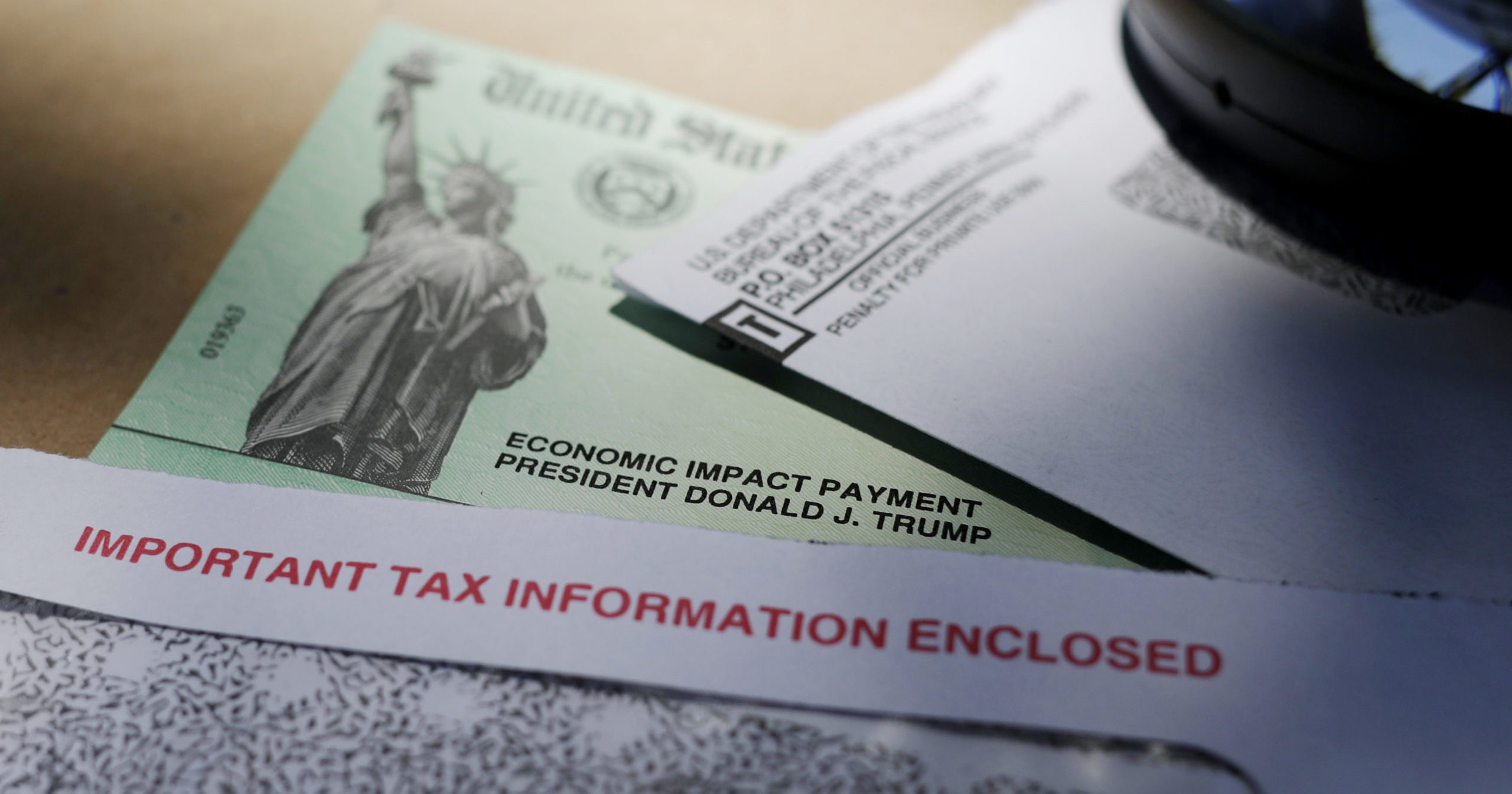 President Donald Trump's name is seen on a stimulus check issued by the IRS to help combat the adverse economic effects of the COVID-19 government shutdowns.