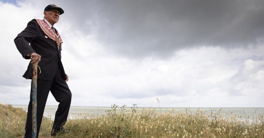 Charles Norman Shay, a World War II D-Day veteran from Maine, poses on the dune overlooking Omaha Beach prior to a ceremony in Saint-Laurent-sur-Mer, Normandy, France, on June 5, 2020. Saturday's anniversary of D-Day will be one of the loneliest remembrances ever, as the coronavirus pandemic is keeping almost everyone away.