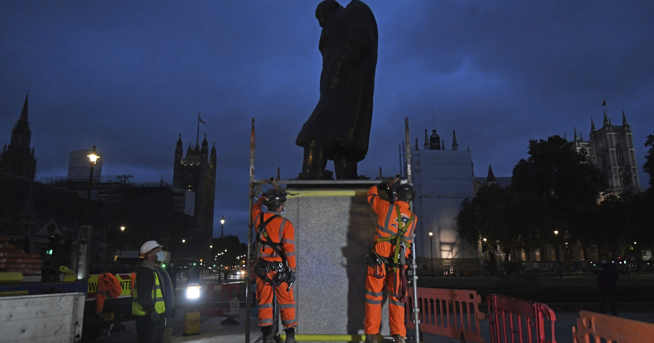 Scaffolders erect boarding around the statue of Sir Winston Churchill at Parliament Square, in London on June 11, 2020, following Black Lives Matter protests that took place across the U.K. over the weekend.