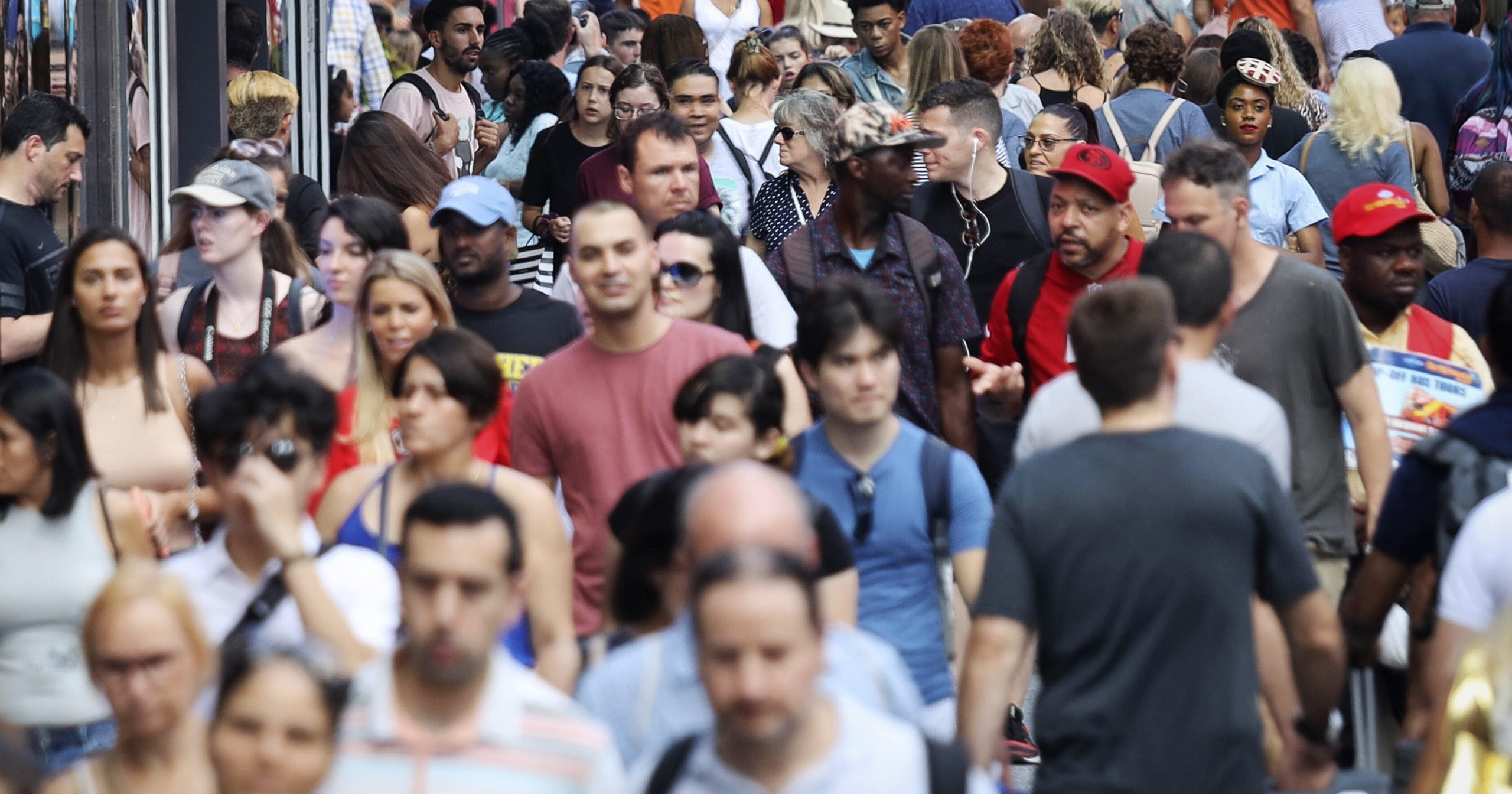 In this Aug. 22, 2019, file photo, people walk through New York's Times Square. The population of non-Hispanic whites in the U.S. has gotten smaller in the past decade as deaths have surpassed births in this aging demographic, and a majority of the population under age 16 is nonwhite for the first time though they are fewer in number than a decade ago, according to new figures released June 25, 2020, by the U.S. Census Bureau.