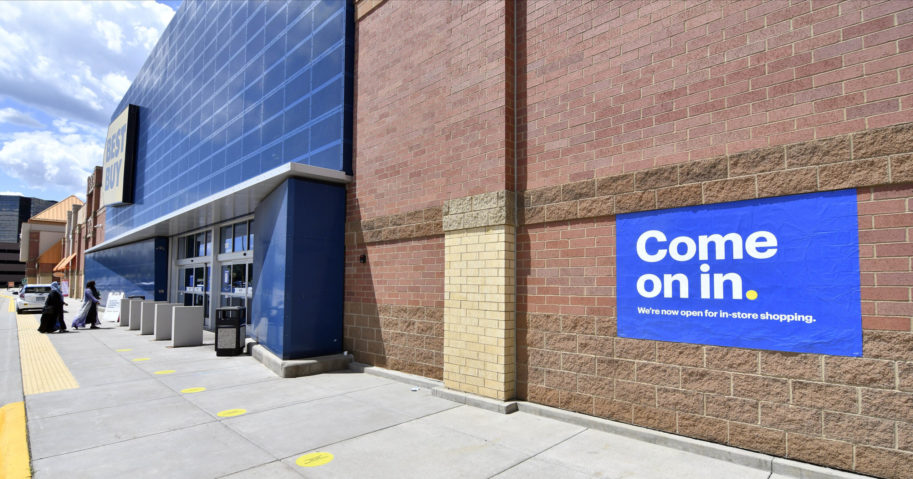 Shoppers head to the entrance as a sign invites customers to shop inside a Best Buy store on June 24, 2020, in Richfield, Minnesota. Restrictions due to the coronavirus have eased in Minnesota.