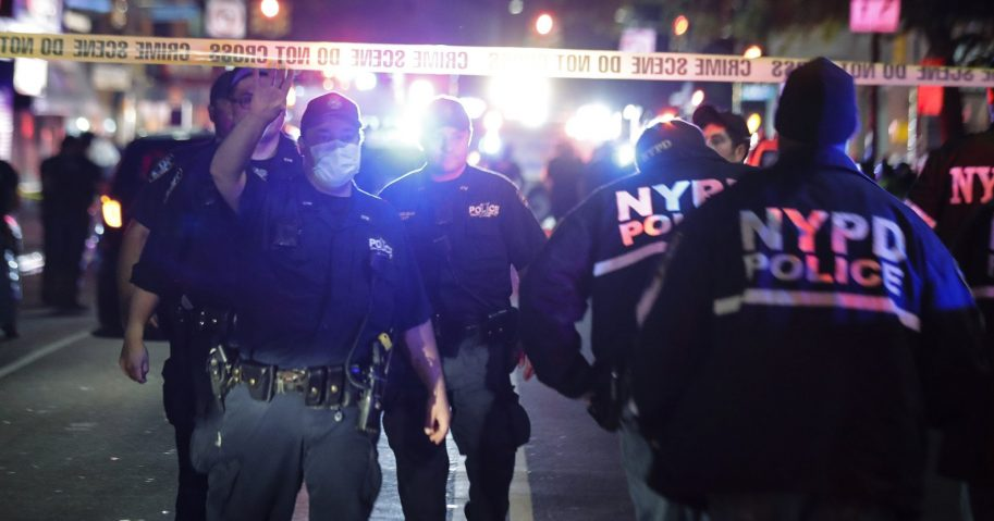 New York City police officers work a scene on June 4, 2020, in the Brooklyn borough of New York. The police department says an officer has been shot in Brooklyn. The shooting happened late Wednesday, nearly four hours after an 8 p.m. curfew went into effect intended to quell unrest over the death of George Floyd in Minnesota.