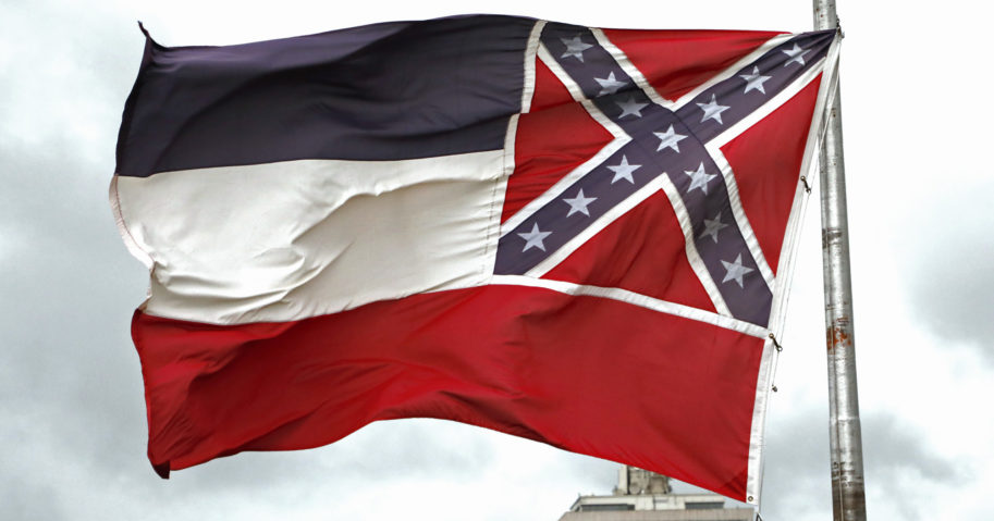 A Mississippi state flag flies outside the Capitol in Jackson, Mississippi, on June 25, 2020.