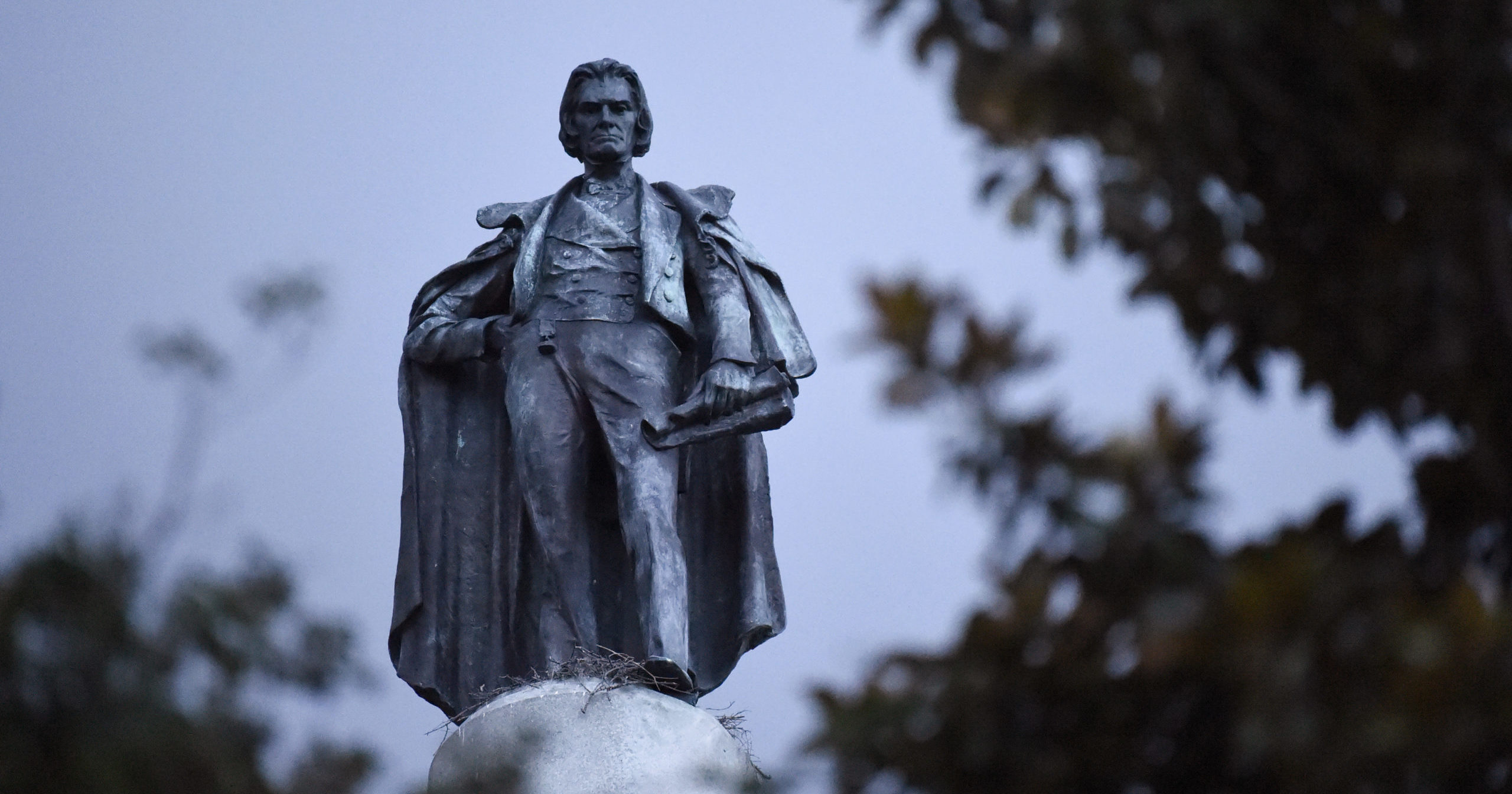 A 100-foot monument to former U.S. vice president and slavery advocate John C. Calhoun towers over a downtown square on June 23, 2020, in Charleston, South Carolina. Officials in Charleston voted unanimously Tuesday to remove the statue.