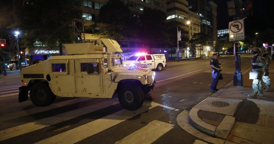 A military Humvee blocks an intersection along K Street in downtown Washington, D.C. as demonstrators protest the death of George Floyd on Monday, June 1, 2020. Floyd died after being restrained by Minneapolis police officers.
