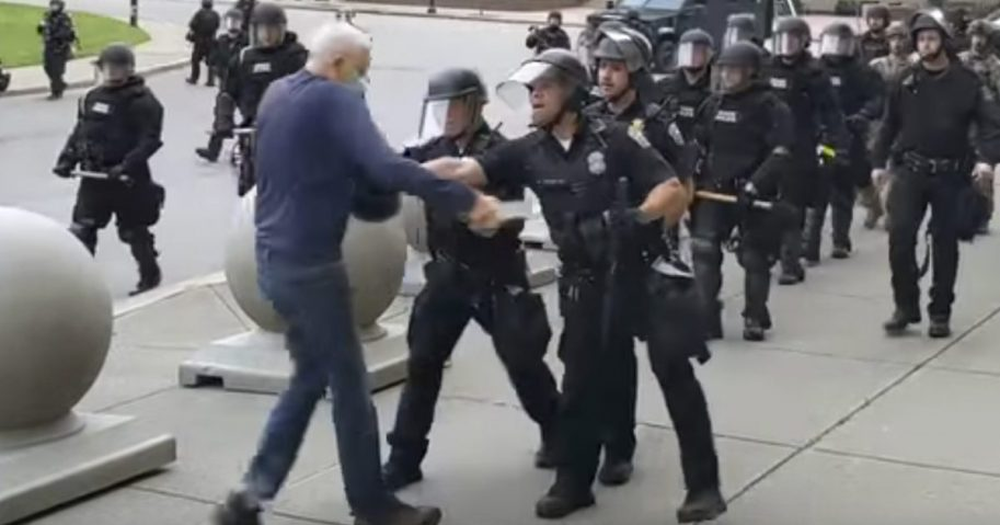 a Buffalo police officer appears to shove a man