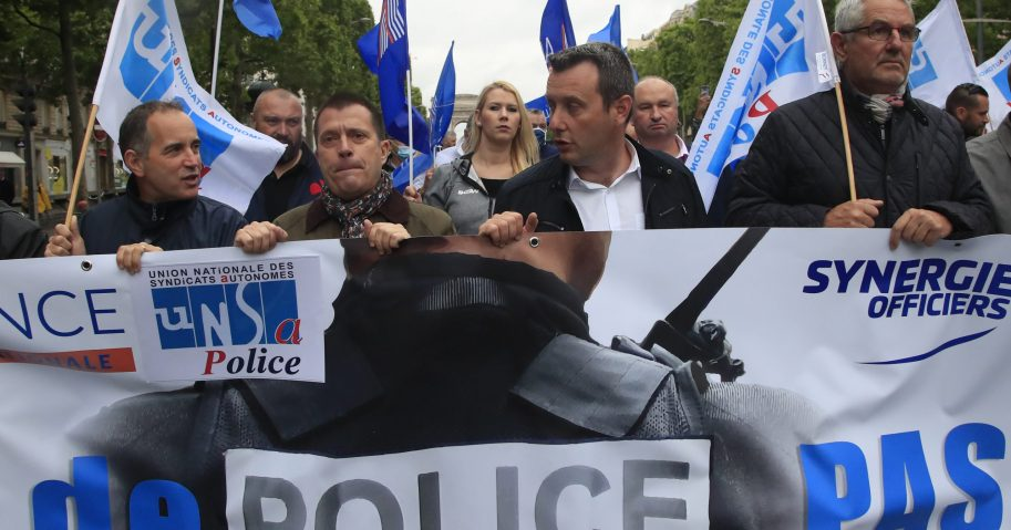 French police unionists demonstrate with a banner reading 'No police, no peace' on the Champs-Elysee avenue on June 12, 2020, in Paris. French police are protesting a new ban on chokeholds and implications of racism within their ranks.