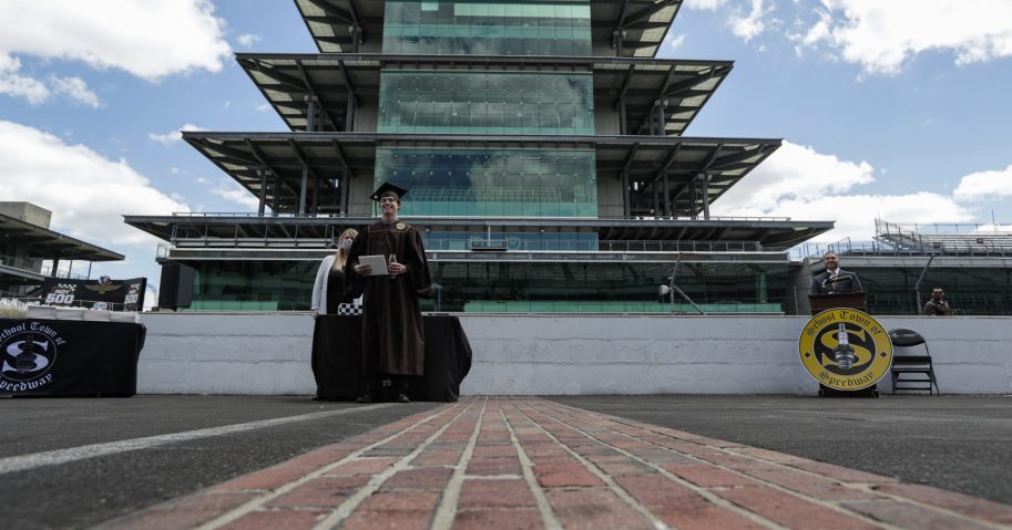 Eli Collins receives his Speedway High School diploma during a ceremony on the start/finish line at the Indianapolis Motor Speedway in Indianapolis on May 30, 2020. The ceremony was held at the track to allow for social distancing requirements due to the coronavirus pandemic.