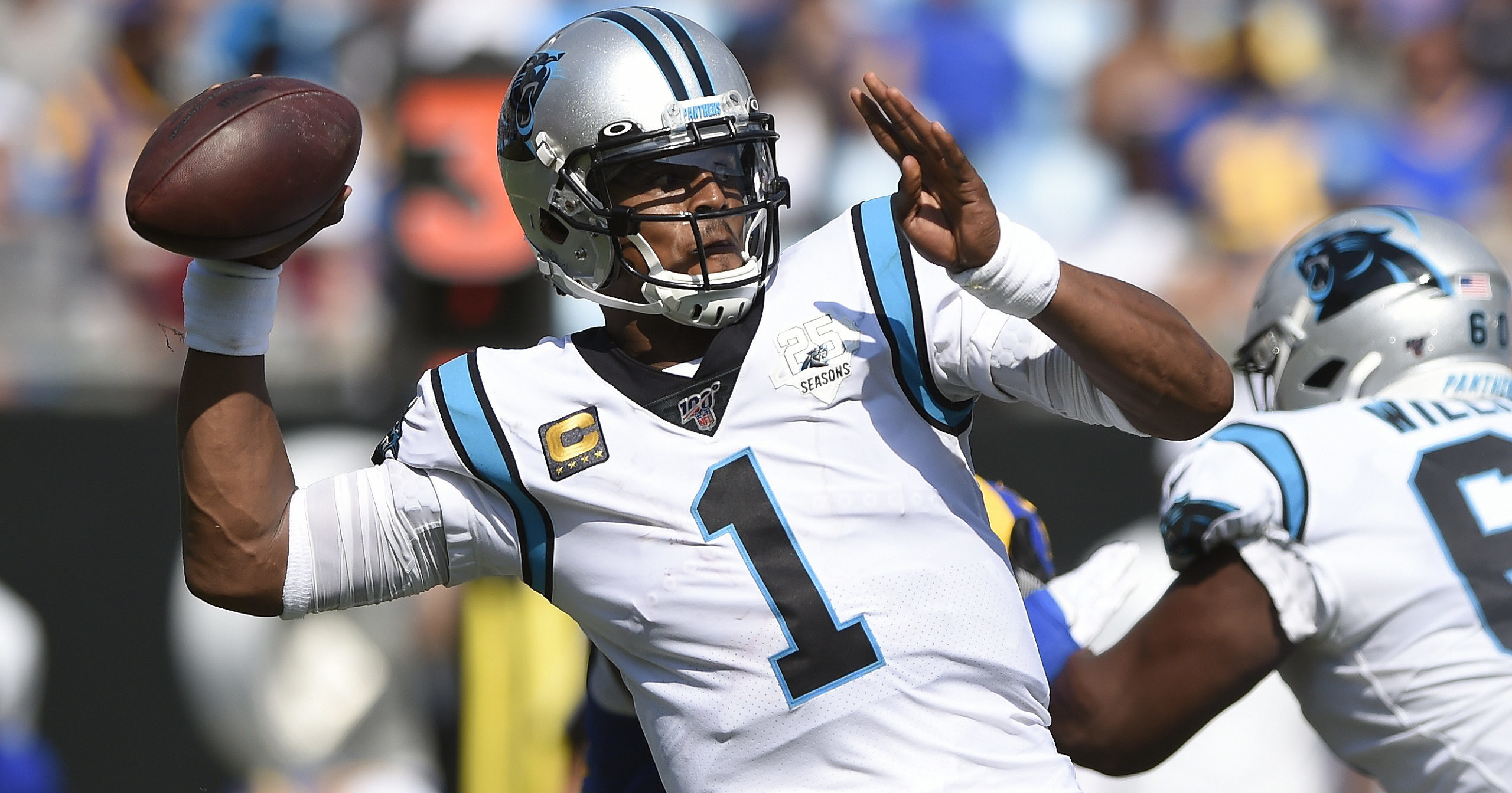 Cam Newton looks for a receiver during the Carolina Panthers' 30-27 loss to the Los Angeles Rams on Sept. 9, 2019.