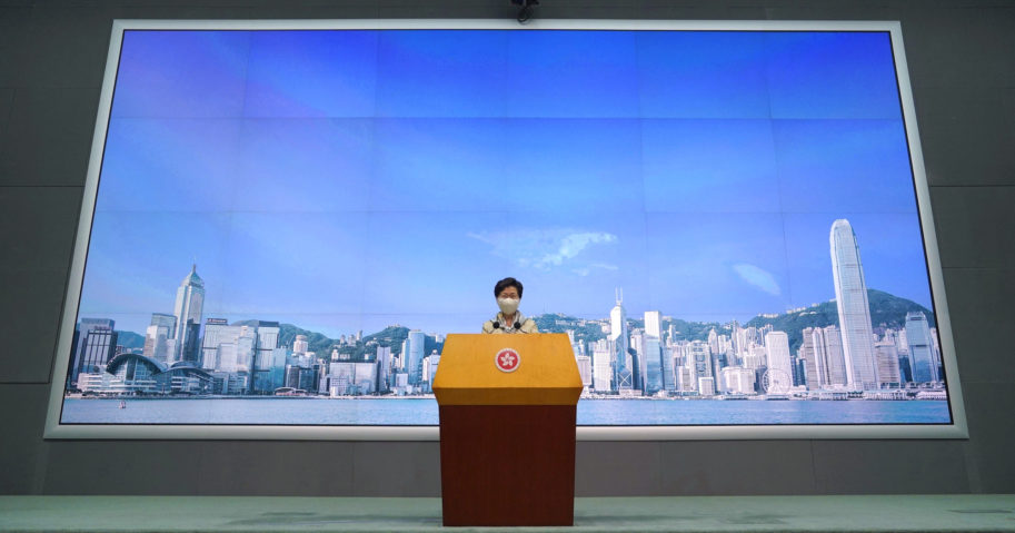 Hong Kong Chief Executive Carrie Lam listens to reporter's questions during a news conference in Hong Kong on June 30, 2020.