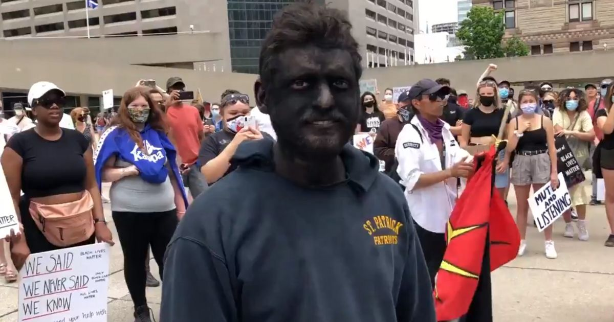 A man showed up in blackface as demonstrators were gathered in Toronto's Nathan Phillips Square.