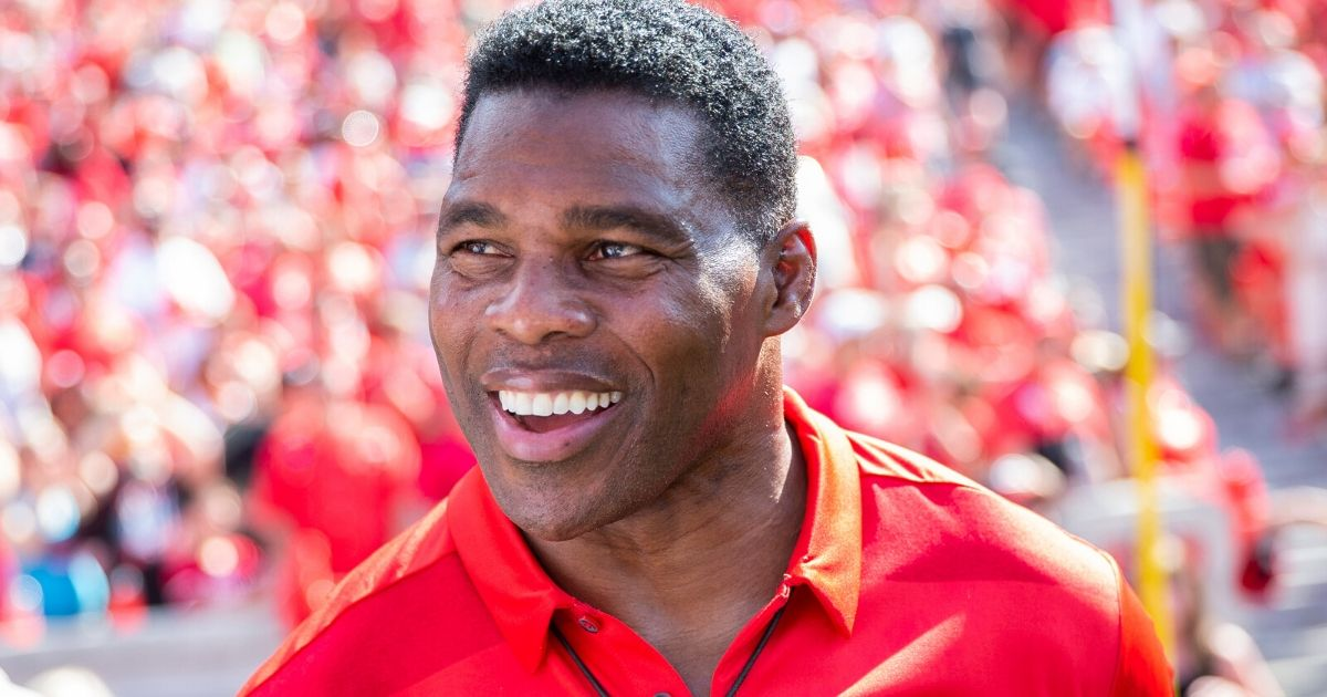 Former Georgia star Herschel Walker is on the sidelines during a game between the Bulldogs and Murray State at Sanford Stadium in Athens on Sept. 7, 2019.