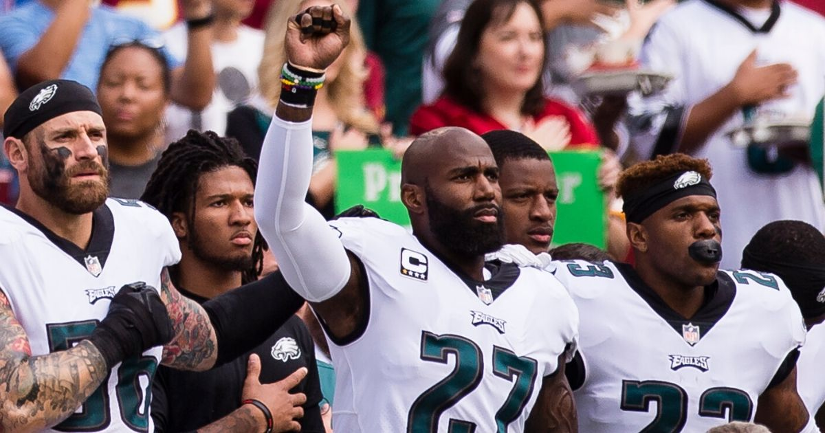 Malcolm Jenkins, then with the Philadelphia Eagles, raises his fist in protest during the national anthem before a game against the Washington Redskins at FedEx Field on Sept. 10, 2017.