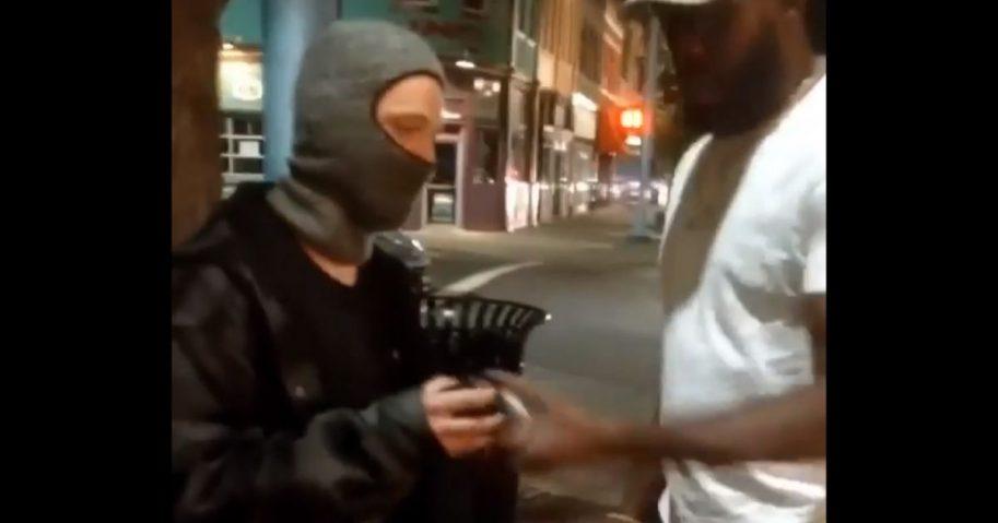"UFC champ Jon ""Bones"" Jones confronts masked vandals with spray paint cans."