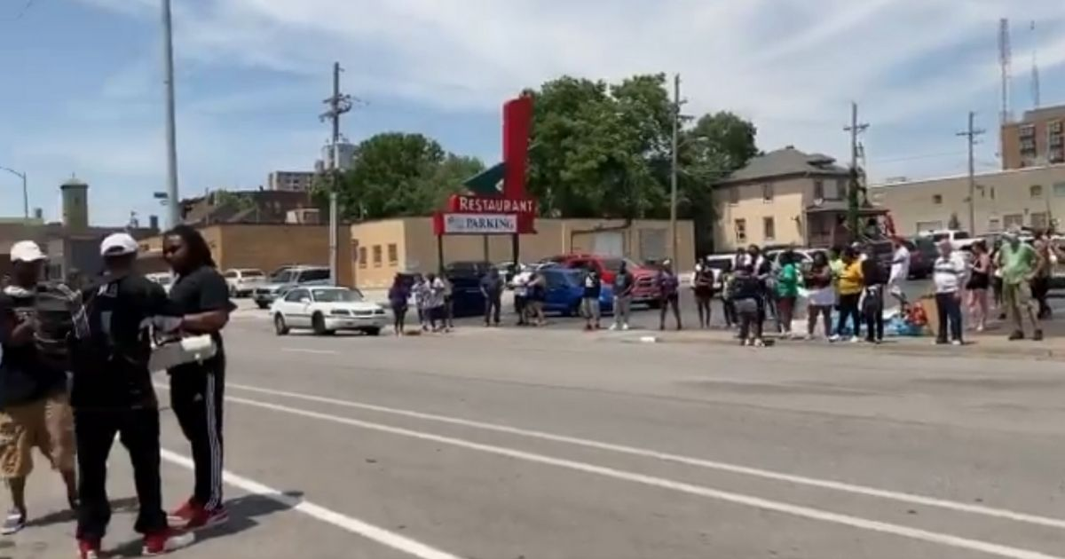 Black Lives Matter activists protest in front of the entrance and parking lot of the 11-Worth Cafe in Omaha, Nebraska.