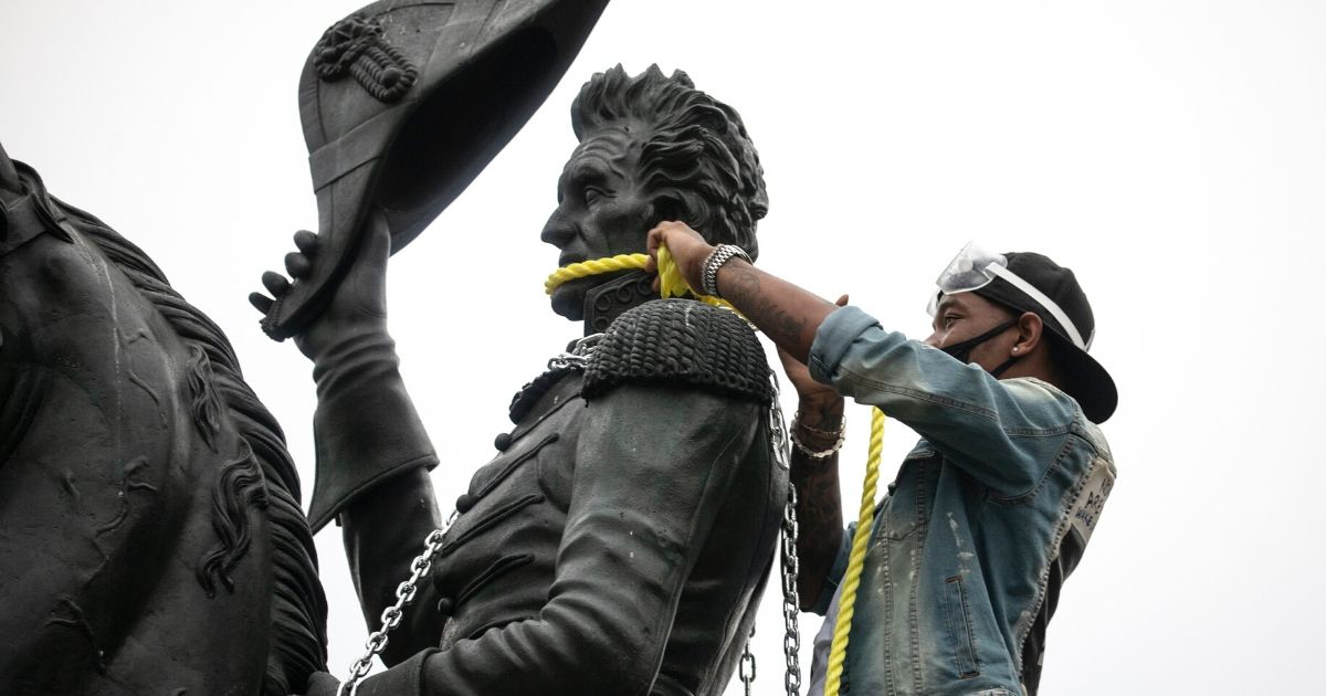Protesters attempt to pull down the statue of Andrew Jackson in Lafayette Square near the White House on June 22, 2020, in Washington, D.C.