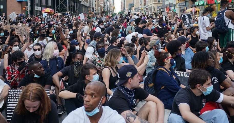 Protesters sit in 42nd Street near Times Square in New York on June 7, 2020, as they demonstrate over the death of George Floyd in Minneapolis police custody.