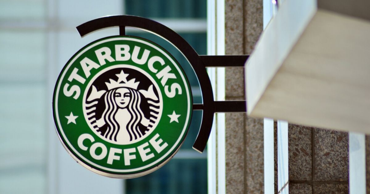A stock photo of a Starbucks is seen above.