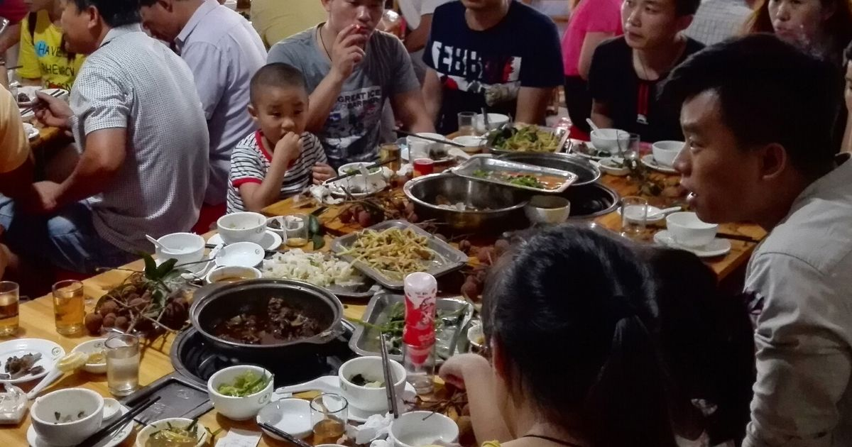 People eat dog meat at a restaurant in Yulin, in China's southern Guangxi region, on June 21, 2017.