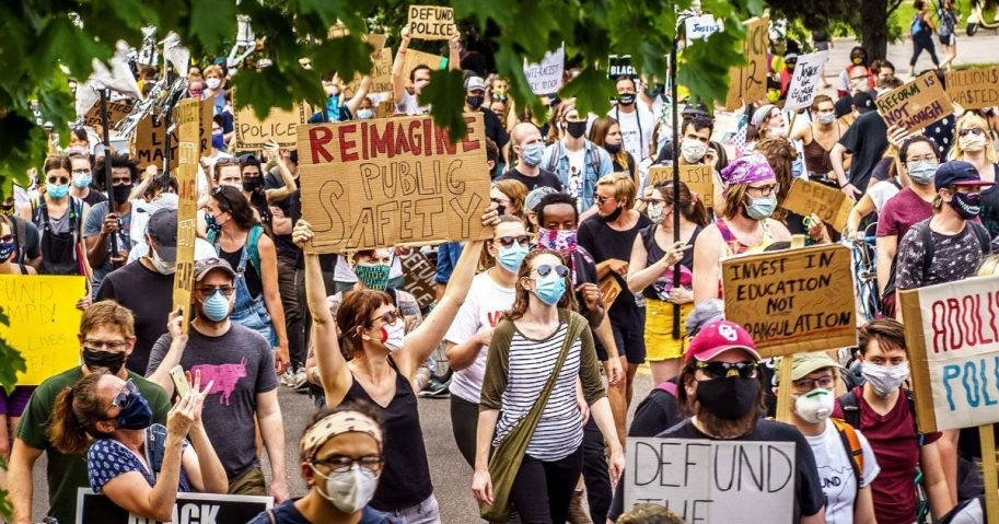 Demonstrators march to defund the Minneapolis Police Department on June 6, 2020, in Minneapolis.