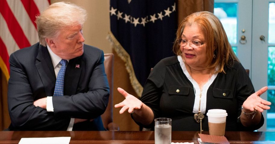 President Donald Trump listens to Dr. Alveda King, niece of Dr. Martin Luther King Jr., during a meeting with inner city pastors at the White House on Aug. 1, 2018.