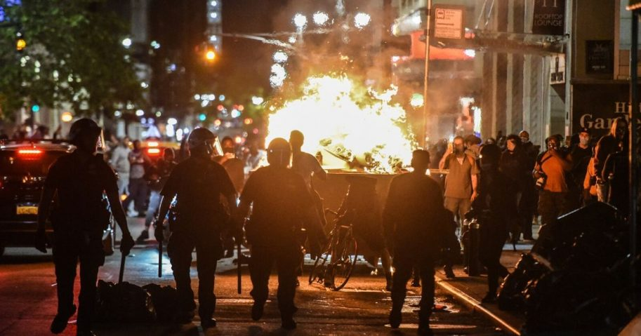 Rioters set a dumpster on fire on May 31, 2020, in New York City.