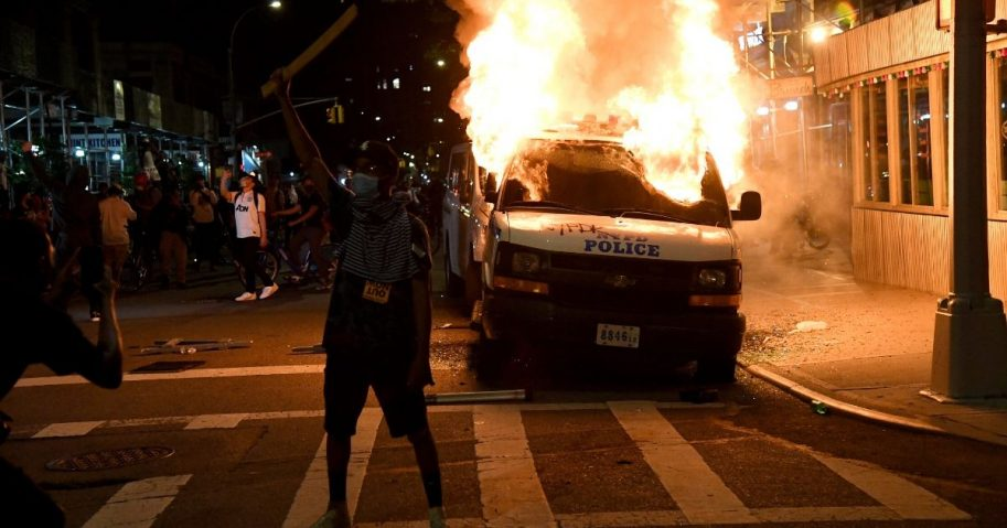 A New York City Police Department van burns near Union Square on May 30, 2020, in New York City.