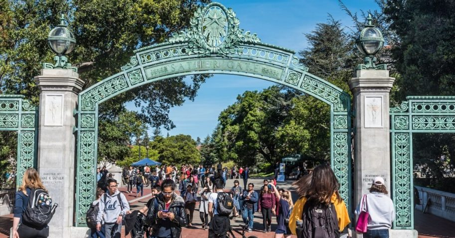 Students pass through Sather Gate, a landmark built in 1910, connecting Sproul Plaza to the center of the college campus at the University of California, Berkeley.