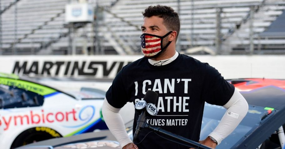 "Bubba Wallace, driver of the #43 Richard Petty Motorsports Chevrolet, wears an ""I Can't Breathe - Black Lives Matter"" T-shirt prior to the NASCAR Cup Series Blue-Emu Maximum Pain Relief 500 at Martinsville Speedway on June 10, 2020, in Martinsville, Virginia."