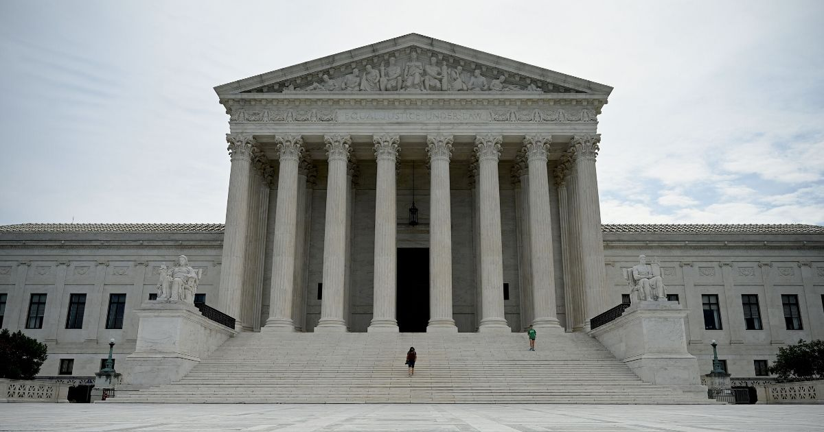 A woman walks down the steps of the U.S. Supreme Court on June 15, 2020, in Washington, D.C.
