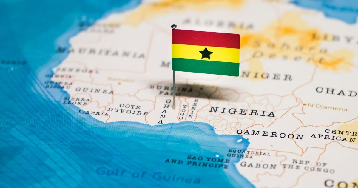 Stock image of the flag of Ghana on a map of Africa.