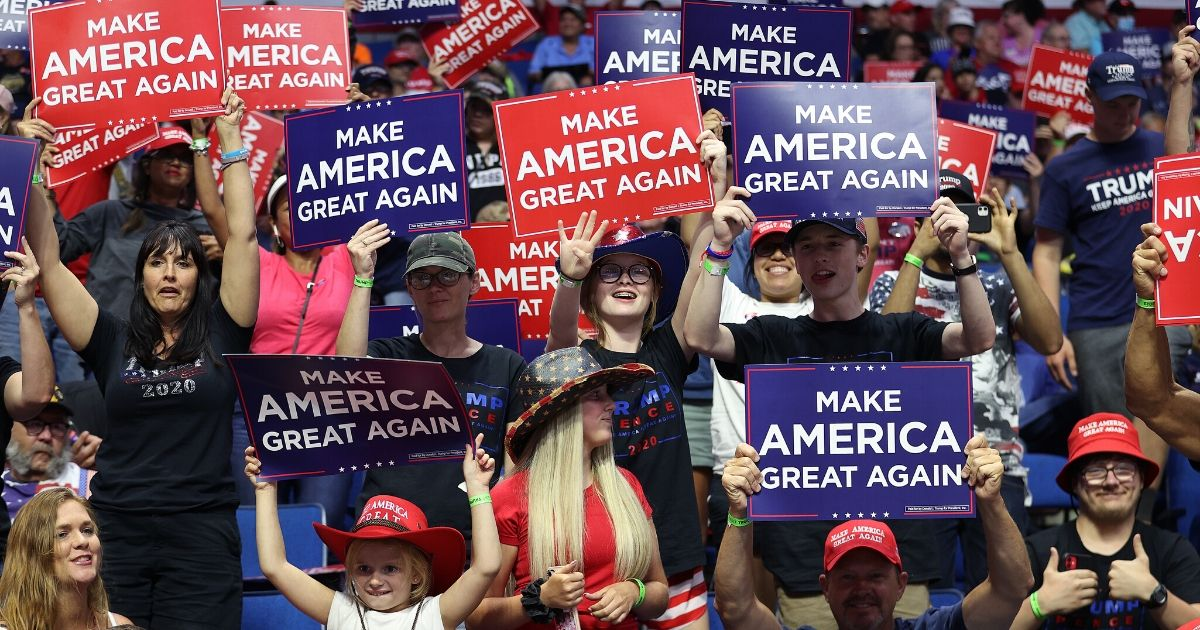 Supporters hold up signs during a campaign rally for President Donald Trump at the BOK Center on June 20, 2020, in Tulsa, Oklahoma.