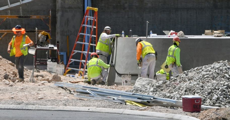 Construction crews work on the base of the Al Davis memorial torch at the entrance of the 336,000-square-foot Las Vegas Raiders Headquarter under construction on June 10, 2020, in Henderson, Nevada.